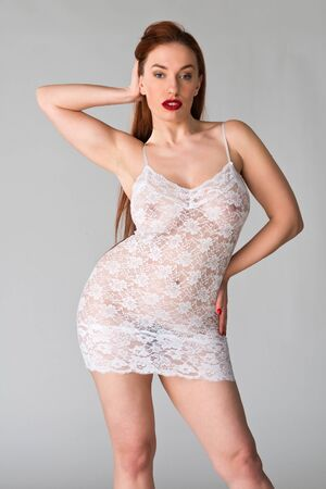 Pretty young redhead in a sheer white slip Stock Photo - 18060959