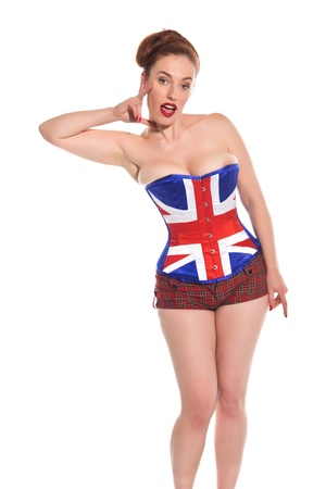 Pretty young redhead in a Union Jack corset