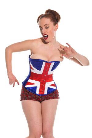 Pretty young redhead in a Union Jack corset photo