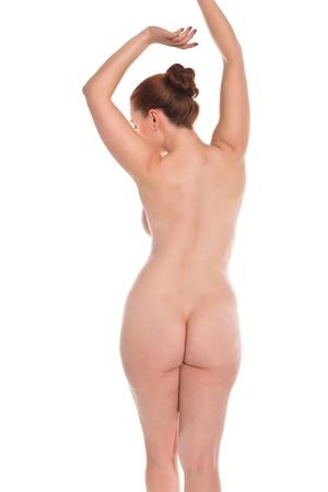 mujer desnuda de espalda: Bastante joven pelirroja posando desnuda en blanco