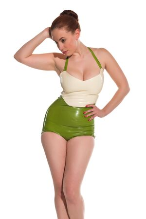 Pretty young redhead in green and white latex photo