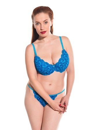 Pretty young redhead dressed in turquoise lingerie Stock Photo - 18346733