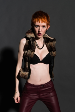 Pretty slender redhead in a fake fur jacket Stock Photo - 18334685