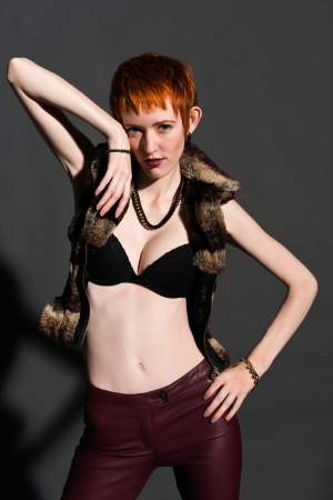 Pretty slender redhead in a fake fur jacket Stock Photo - 18346703