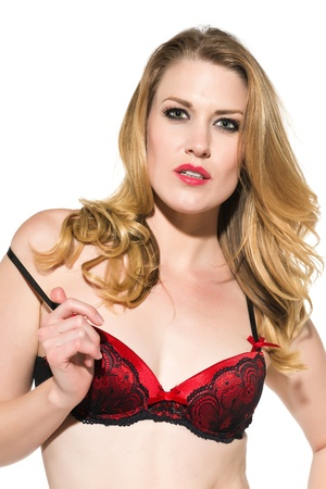 Beautiful pale blonde in red and black lingerie Stock Photo - 18346672
