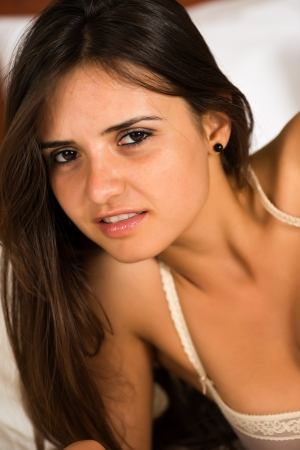 Pretty young Romanian woman in mauve lingerie photo