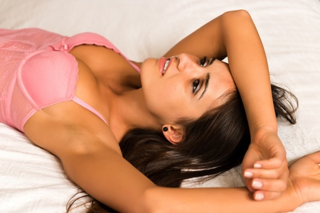 Pretty young Romanian woman in pink lingerie photo