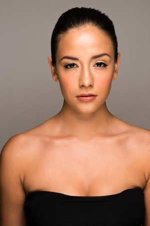 bare shoulders: Portrait of a pretty young brunette with bare shoulders Stock Photo