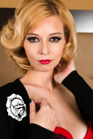 Pretty blonde woman in red and black Stock Photo - 19429015