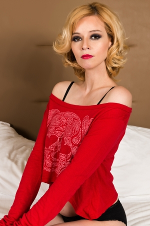 is slender: Pretty slender blonde in a red t-shirt