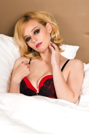Pretty blonde woman in red and black Stock Photo - 19429044