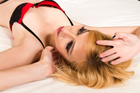 Pretty blonde woman in red and black photo