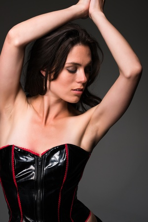 Pretty slender brunette in a black corset