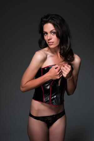 Pretty slender brunette in a black corset Stock Photo - 19534636