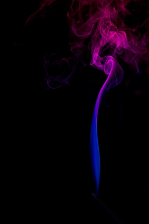 Smoke trail rising from a burning stick of incense