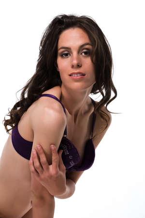 brassiere: Pretty slender brunette in a purple brassiere Stock Photo