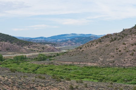 Winding road through the mountains near Fort Garland, Colorado photo