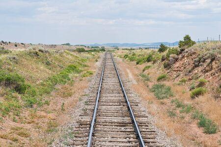 Railroad tracks through colorful grass field near La Veta, Colorado Reklamní fotografie - 20831369