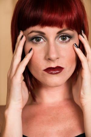 Closeup on the face of a pretty petite redhead photo