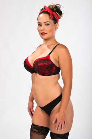 Shapely multiracial brunette in red and black lingerie photo