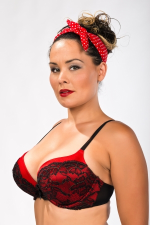 Shapely multiracial brunette in a red and black bra