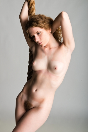 Pretty slender nude redheaded dancer
