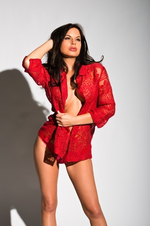 shapely: Beautiful shapely brunette in a red blouse Stock Photo