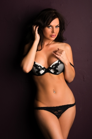 bra panties: Beautiful shapely brunette in black and white lingerie Stock Photo