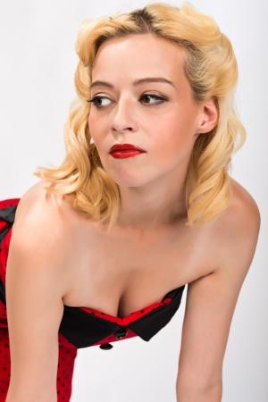 Pretty petite blonde in a strapless red dress photo