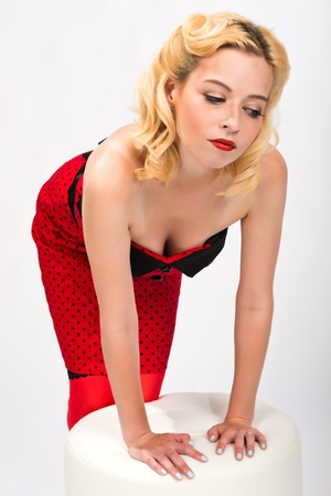 Pretty petite blonde in a strapless red dress photo