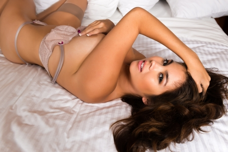 Beautiful young Eurasian woman in pale mauve lingerie Stock Photo