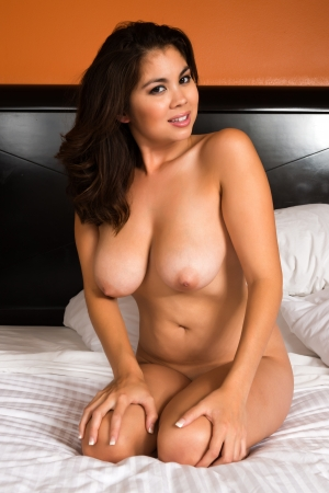 asia nude: Beautiful young Eurasian woman sitting in bed
