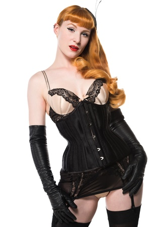 Beautiful young redhead dressed in vintage lingerie photo