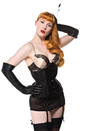 ligueros: Hermosa joven pelirroja vestida con lencer�a vintage