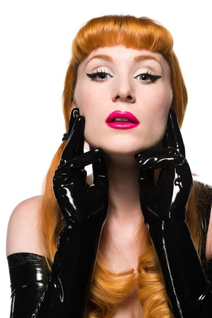 rubber: Closeup on the face of a beautiful redhead in black latex Stock Photo