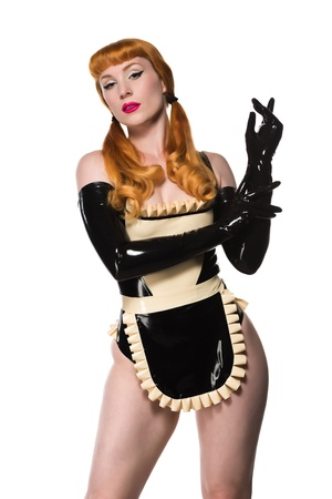 Beautiful young redhead in a latex maid costume