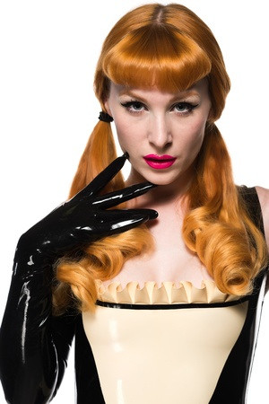 rubber: Beautiful young redhead in a latex maid costume