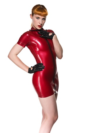 Beautiful young redhead in a red latex dress Stok Fotoğraf