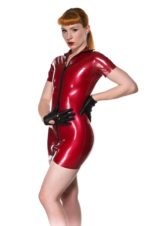 latex fetish: Beautiful young redhead in a red latex dress Stock Photo