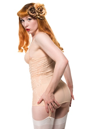 chemise: Beautiful young redhead in a peach color chemise