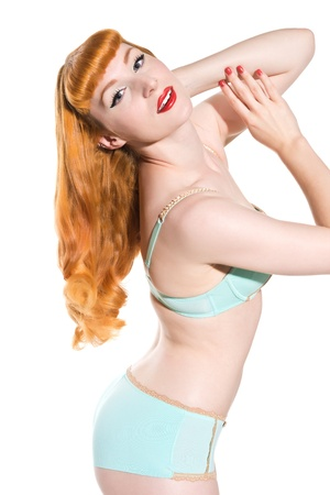 Beautiful young redhead in vintage blue and gold lingerie