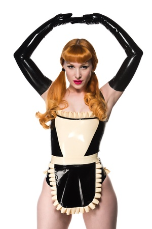 Beautiful young redhead in a latex maid costume photo