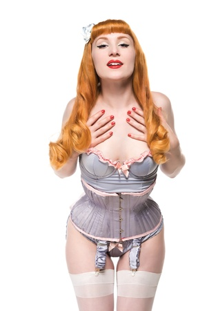 garters: Beautiful young redhead dressed in vintage lingerie