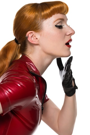 Beautiful young redhead in a red latex dress photo