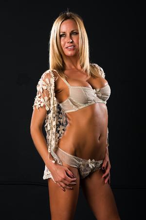 Pretty petite blonde dressed in vintage lingerie photo