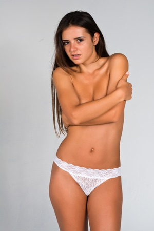undressed young: Slender young Romanian woman nude in white panties