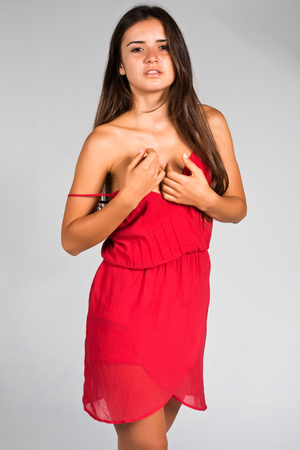 spaghetti strap: Slender young Romanian woman in a red dress