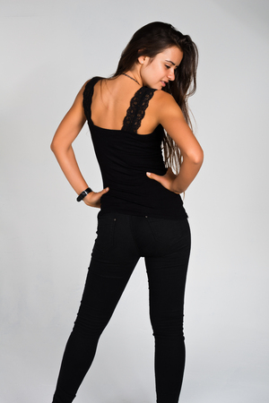 Slender young Romanian woman dressed in black