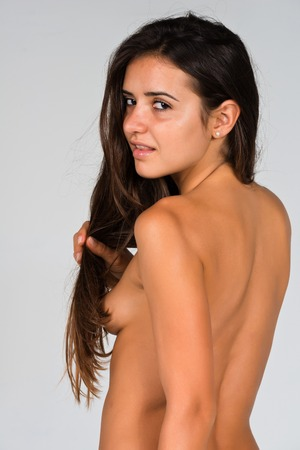 Slender young nude Romanian woman turned away photo