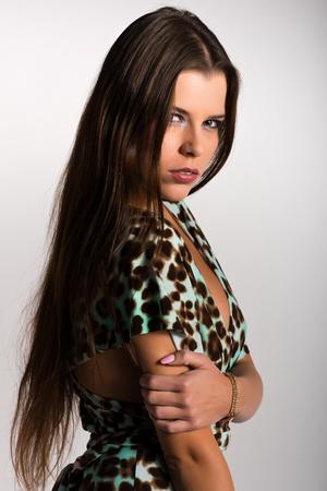 Beautiful slender Ukrainian woman in a leopard print dress photo